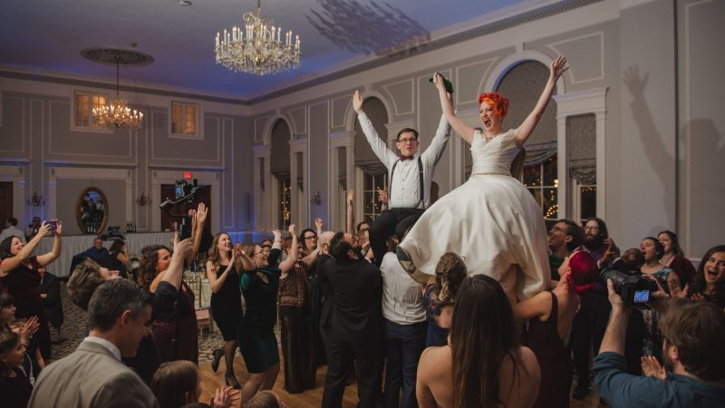 People dancing and celebrating the newlywed couple